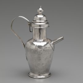 A Silver Ewer With Lid